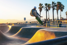 Skateboarder at sunset on Venice Beach