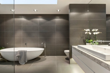 grey-bathroom-with-orchids