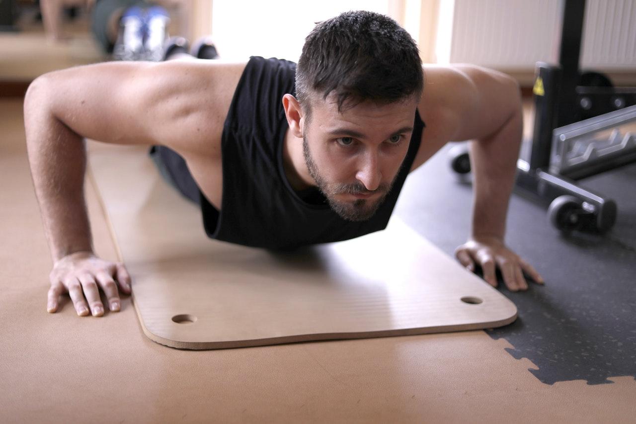 man-in-k-black-tank-top-doing-push-ups-3931108