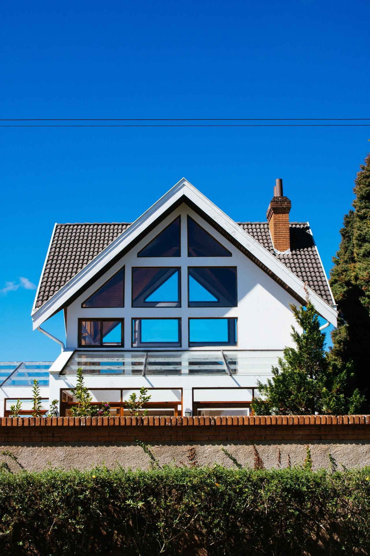 white-concrete-house-under-clear-blue-sky-2371975